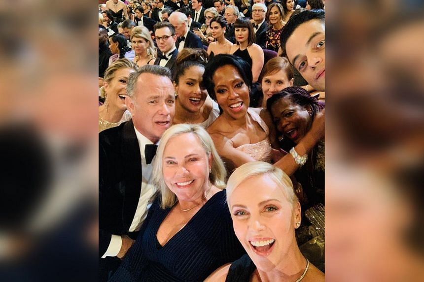 Charlize Theron and her mother Gerda Maritz are seen with Tom Hanks and his wife Rita Wilson, Salma Hayek, Regina King and Rami Malek at the Academy Awards on Feb 9, 2020.