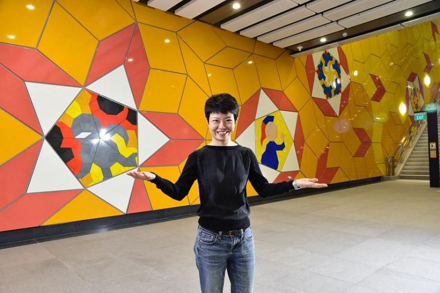 Artist Kng Mian Tze, against the backdrop of her art at the Woodlands South station on Jan 30, 2020.