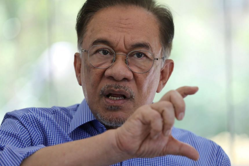 Anwar Ibrahim speaks during an interview with Reuters in Petaling Jaya, Malaysia.