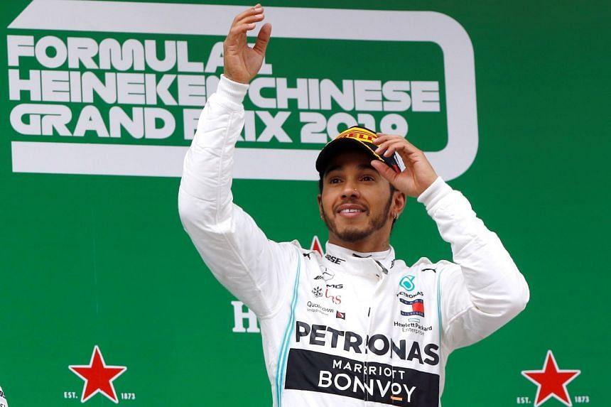 Mercedes' Lewis Hamilton celebrates winning the 2019 Chinese grand prix.