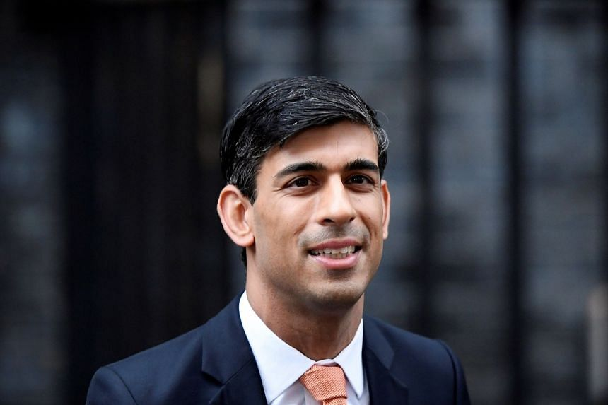 Newly appointed Rishi Sunak, Britain's Chancellor of the Exchequer, leaves Downing Street in London, Feb 13, 2020.