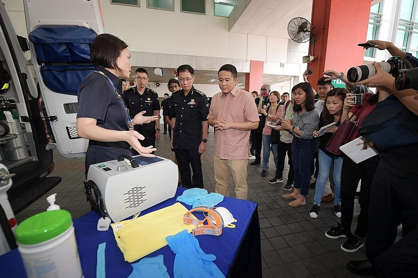 Lieutenant-Colonel Janice Oh, senior assistant director of Singapore Civil Defence Force's Emergency Medical Services Department, telling Senior Parliamentary Secretary for Health Amrin Amin the measures taken to disinfect ambulances that have ferrie