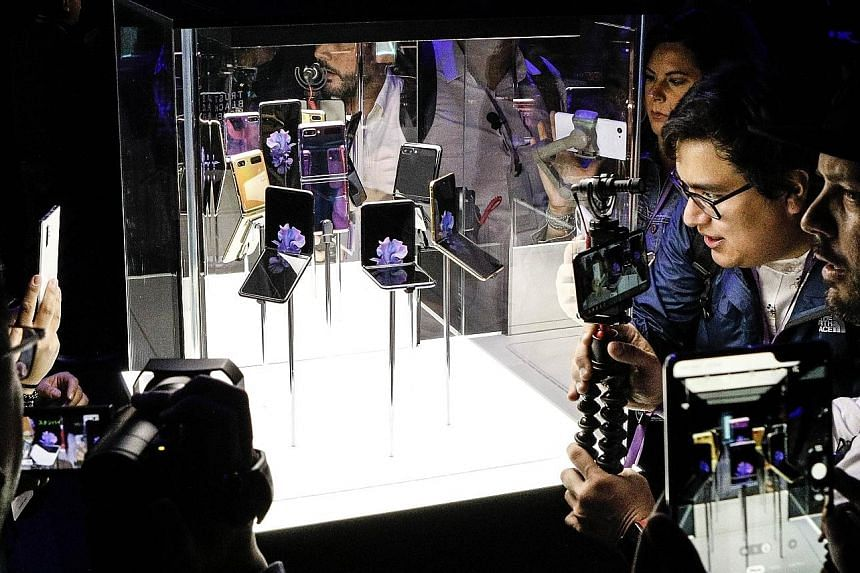 Samsung's Galaxy Z Flip folding smartphone on display in San Francisco, California, on Tuesday. Its clamshell design is a departure from the electronics maker's first foldable phone, the Galaxy Fold, launched last September. PHOTO: AGENCE FRANCE-PRES