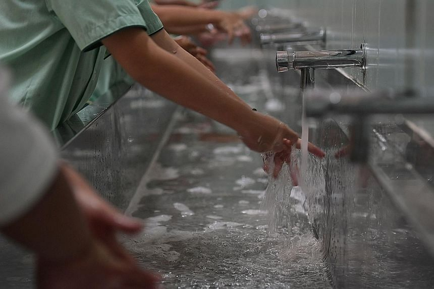 """Farrer Park Primary School pupils washing their hands before mealtime. Pulitzer Prize-winning science writer Laurie Garrett says the coronavirus outbreak is a very serious epidemic and perhaps """"one of the most serious challenges we have faced in at l"""