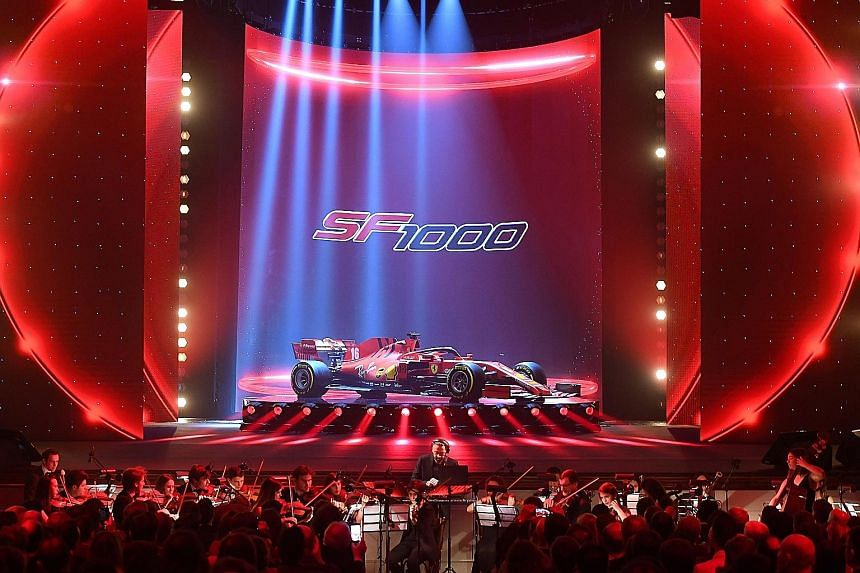 Ferrari's SF1000 being unveiled to considerable fanfare at the Romolo Valli Municipal Theatre, while accompanied by an orchestra in the northern Italian city of Reggio Emilia, some 30km away from Ferrari's home of Maranello. PHOTO: REUTERS