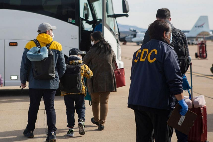 A photo from Feb 5, 2020, shows shows evacuees from China arriving at Marine Corps Air Station Miramar in San Diego, California.