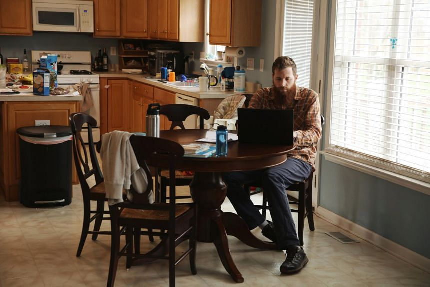 Dexter Lensing, who was studying in China, works on his laptop in Belmont, North Carolina, on Feb 10, 2020.