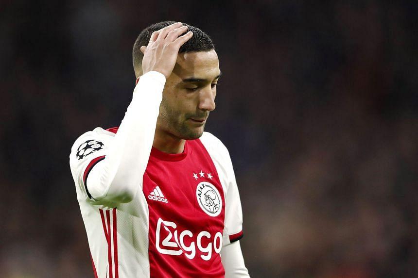 Ajax's Moroccan forward Hakim Ziyech reacts during a match.