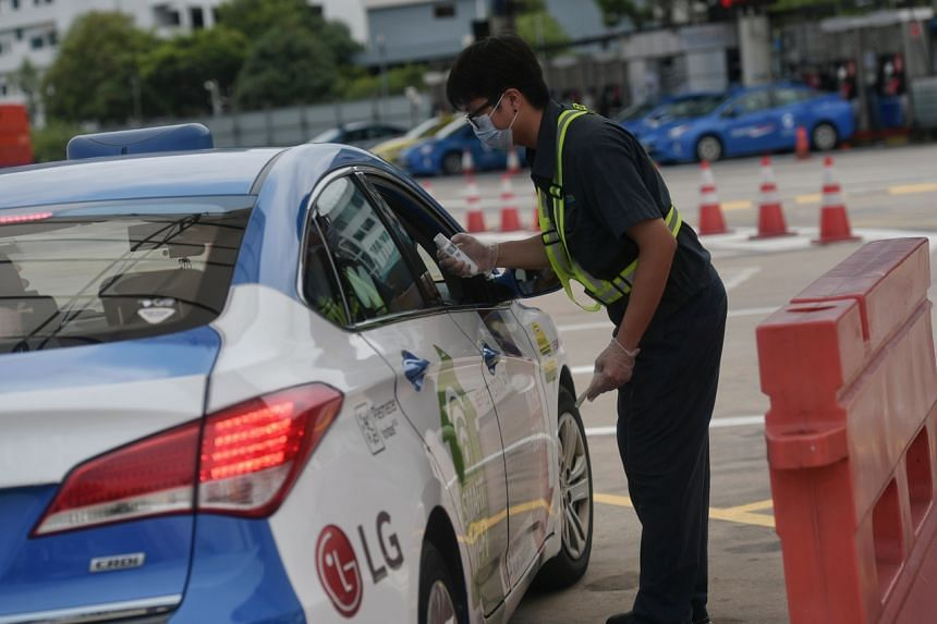 A taxi driver having his temperature checked at the ComfortDelGro office on Feb 12, 2020. Some 40,000 taxi and private-hire drivers will be eligible for a $20 relief each day for three months from Feb 14, 2020.