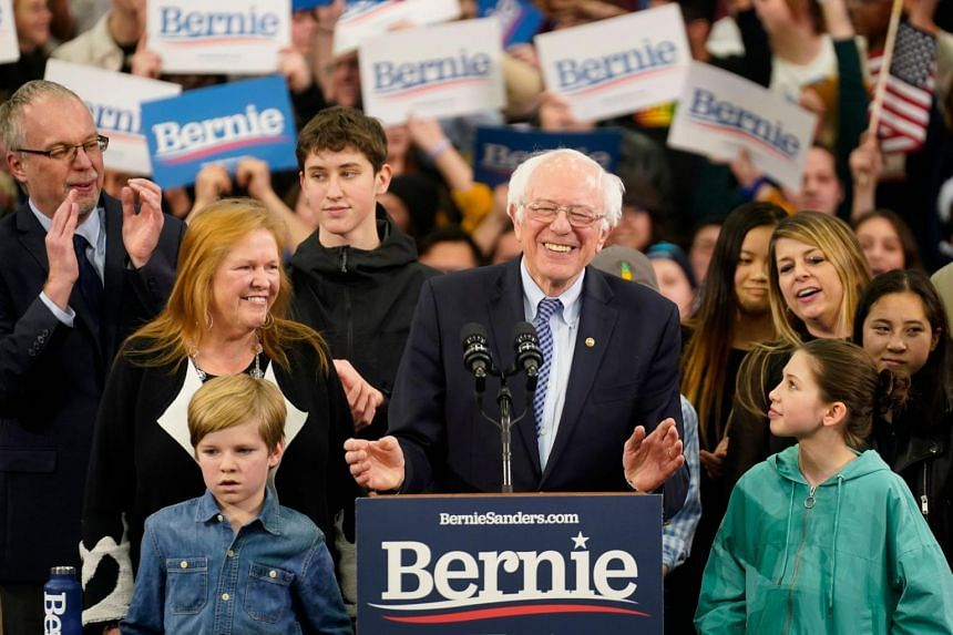 Democratic US presidential candidate Senator Bernie Sanders is accompanied by his wife Jane O'Meara Sanders and other relatives as he speaks at his New Hampshire primary night rally, on Feb 11, 2020.