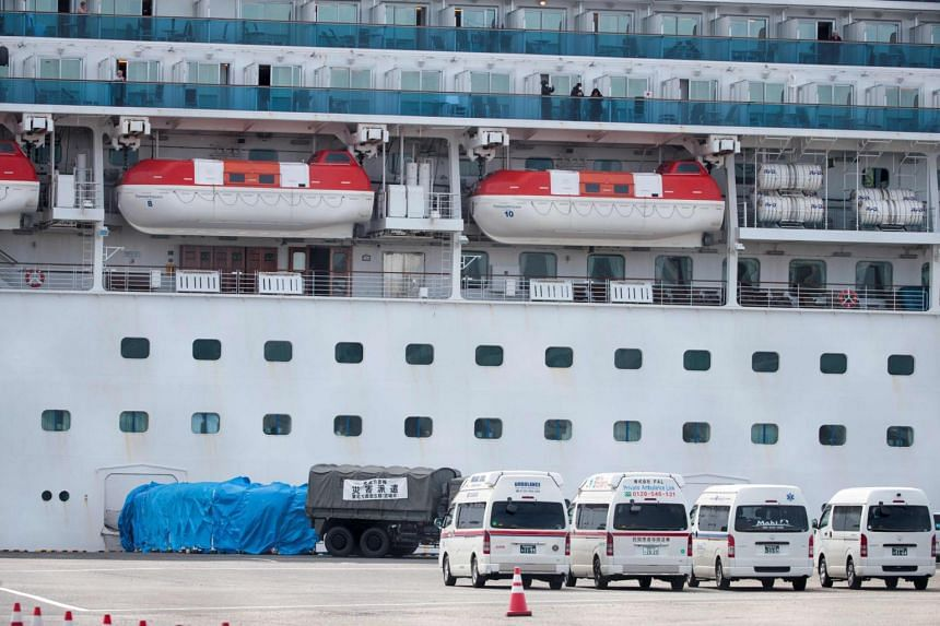 A military vehicle is attached to a gate of the Diamond Princess cruise ship at the Daikoku Pier Cruise Terminal in Yokohama port, on Feb 12, 2020.