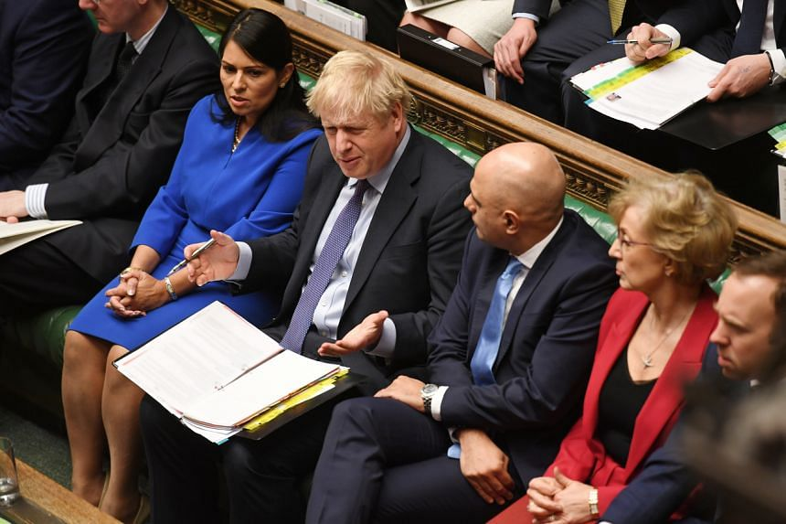 (From left) Home Secretary Priti Patel, Prime Minister Boris Johnson and Chancellor of the Exchequer Sajid Javid attend the weekly question time debate in Parliament in London on Feb 12, 2020.