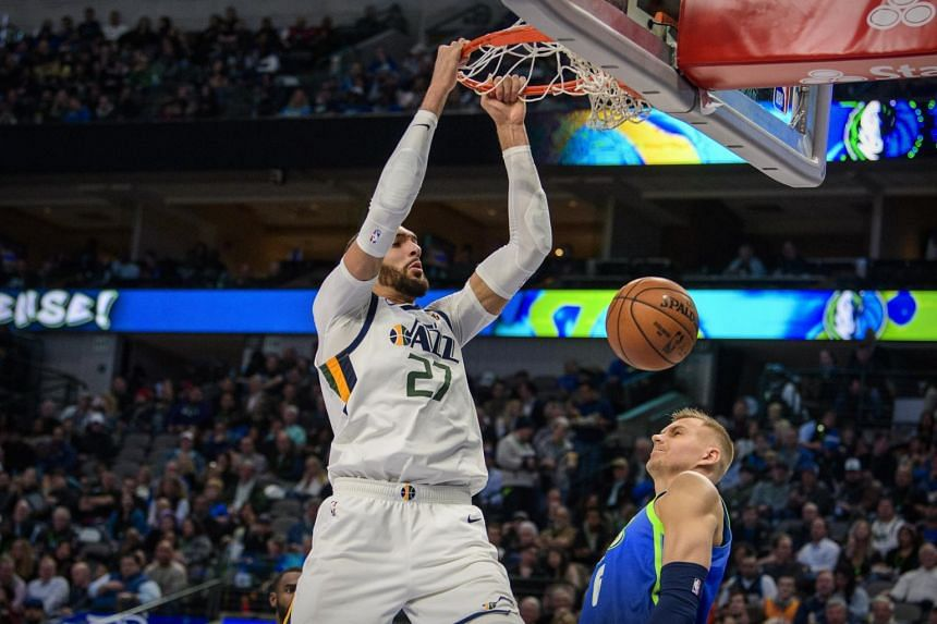 Utah Jazz centre Rudy Gobert (left) dunks the ball over Dallas Mavericks forward Kristaps Porzingis at the American Airlines Centre in Dallas, Texas, on Feb 10, 2020.