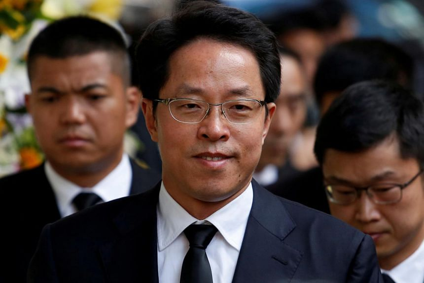 In a photo taken on Oct 13, 2016, director of the Hong Kong and Macau Affairs Office Zhang Xiaoming attends the funeral of Hong Kong property group New World Development Cheng Yu-tung.