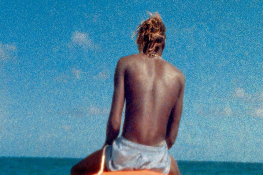 A video still artwork of Ashes (above), in which Steve McQueen pays tribute to a young fisherman from Grenada who was killed by drug traffickers.