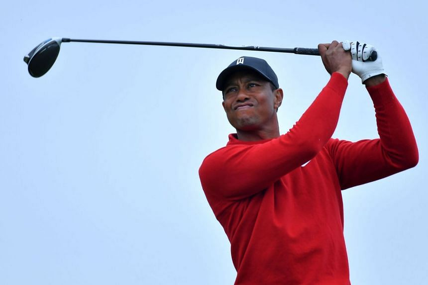 Tiger Woods, seen at last month's Farmers Insurance Open at Torrey Pines, will be aiming for a record 83rd tour title this week.