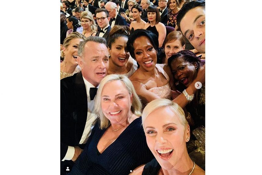 THE OBLIGATORY OSCAR WEFIE: Charlize Theron (foreground) did not win a Best Actress Oscar on Sunday, but she made sure she surrounded herself with high achievers. In a wefie that she posted and which has drawn online attention, she and her mother Ger