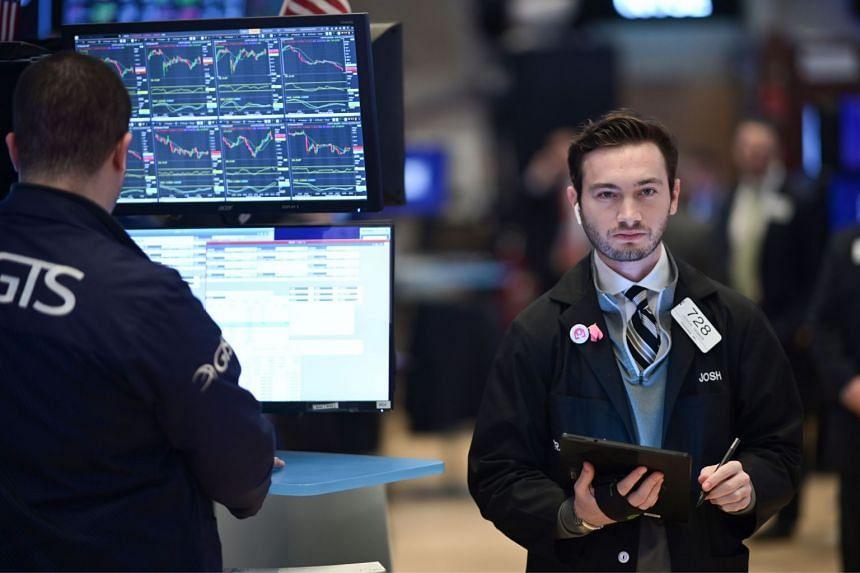 Traders work on the floor of the New York Stock Exchange on Feb 7, 2020.