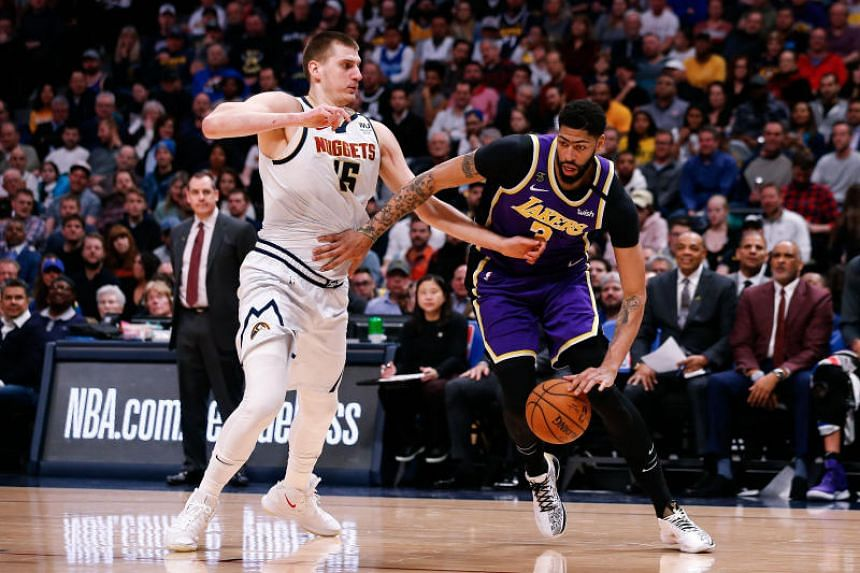 Los Angeles Lakers forward Anthony Davis (3) controls the ball as Denver Nuggets center Nikola Jokic (15) defends in the second quarter at the Pepsi Centre in Denver, Colorado, on Feb 12, 2020.