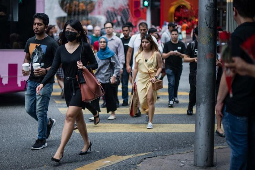 A woman wears a protective face mask, amid fears over the spread of the Covid-19 coronavirus, in Kuala Lumpur on Feb 13, 2020.