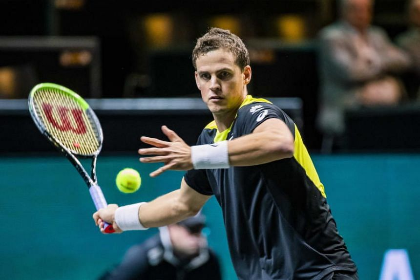 Canada's Vasek Pospisil plays against Russia's Daniil Medvedev on the third day of the ABN AMRO World Tennis Tournament in Rotterdam, Netherlands, on Feb 12, 2020.