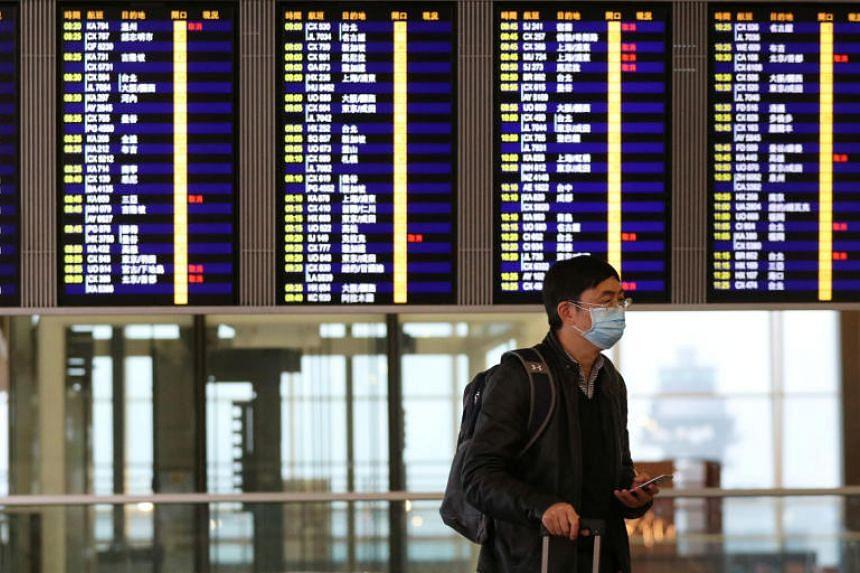 In a photo taken on Feb 7, 2020, a passenger wears a protective mask as he walks through Hong Kong International Airport.