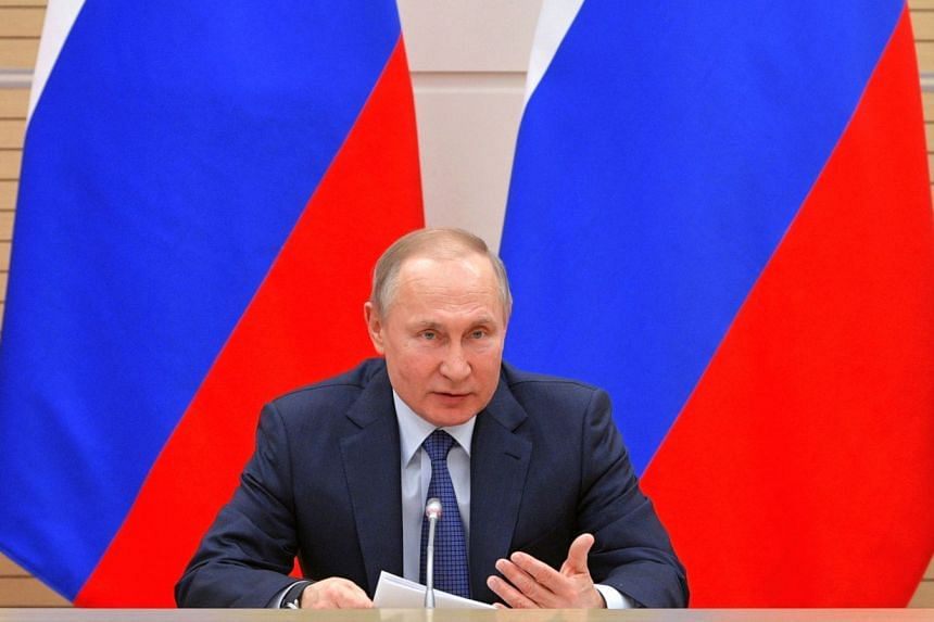 Putin speaks during a working group meeting on the Russian Constitution outside Moscow, Feb 13, 2020.