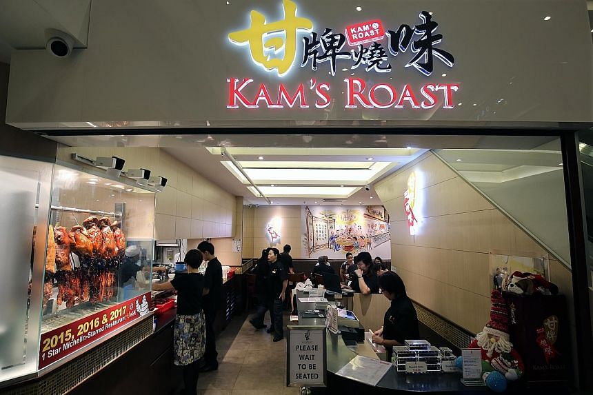 Kam's Roast, with outlets in Pacific Plaza (left) and Jewel Changi Airport, has reported a 50 per cent drop in business since the coronavirus outbreak. A restaurant in Tiong Bahru Plaza at about 2.30pm yesterday. Jewel Changi Airport is offering its