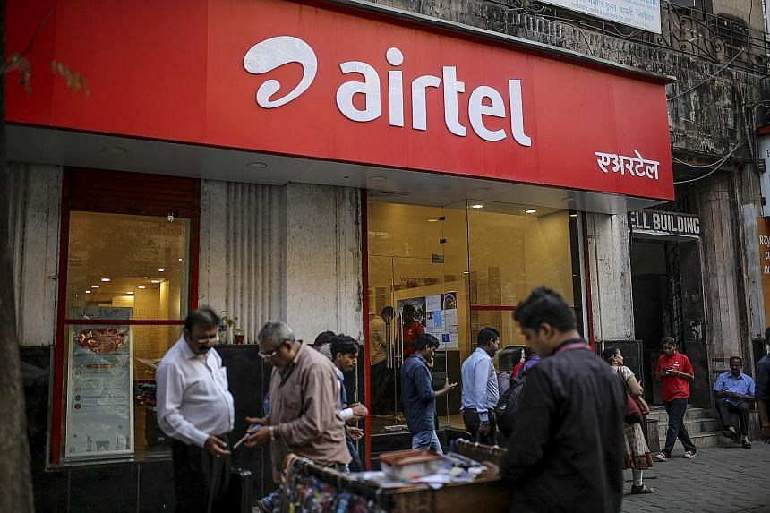 "A Bharti Airtel store in Mumbai. Mr Arthur Lang, Singtel's CEO, international, said Bharti's balance sheet is ""rock solid"". Airtel's raising of US$3 billion (S$4.2 billion) through a share placement and convertible bond issue showed confidence in the"