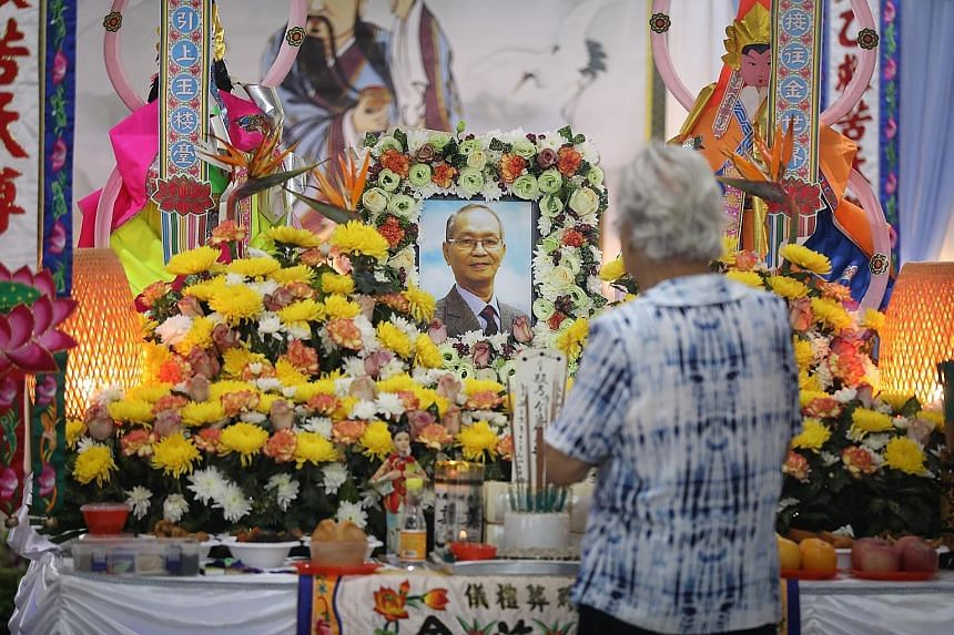 Left: A visitor paying respects at the wake of the late Mr Kee Kin Tiong last month. Mr Kee's body was mistakenly sent to Mandai Crematorium instead of a 70-year-old man's. He was cremated according to Christian funeral rites, when he was in fact Tao