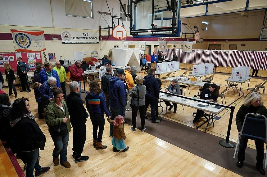 People queueing to vote in Rye, New Hampshire, on Tuesday. In New Hampshire and Iowa, a majority of voters supported candidates closer to the political centre and listed defeating President Donald Trump as their top priority, but there was no overwhe