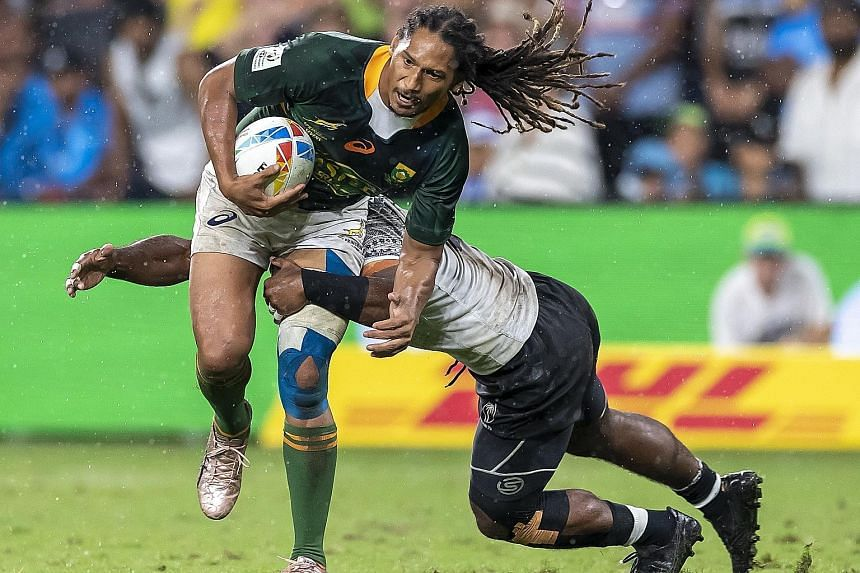 South Africa's Justin Geduld being tackled during the Sydney Sevens final against Fiji earlier this month. HSBC World Rugby Sevens Series defending champions Fiji won the tournament and are fourth in the standings with 53 points. New Zealand are lead