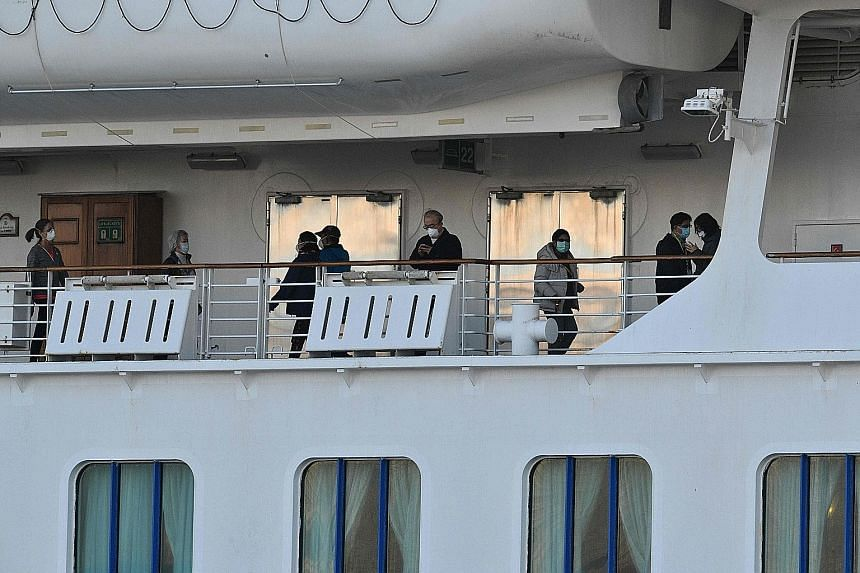 Left: Passengers on the deck of the Diamond Princess, which has the single largest cluster of infected people outside China. Right: The Westerdam arriving in Sihanoukville, on Cambodia's southern coast, yesterday. It had been turned away from several