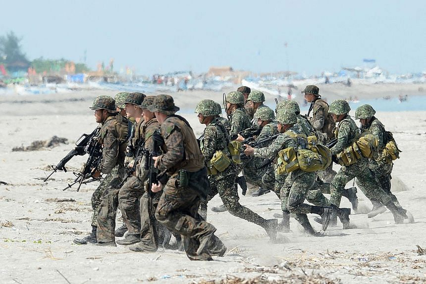A file photo from May 2014 of Philippine and US Marines at a beach exercise facing the South China Sea. President Rodrigo Duterte has announced the termination of the Visiting Forces Agreement, which sets out rules for US soldiers in his country. PHO