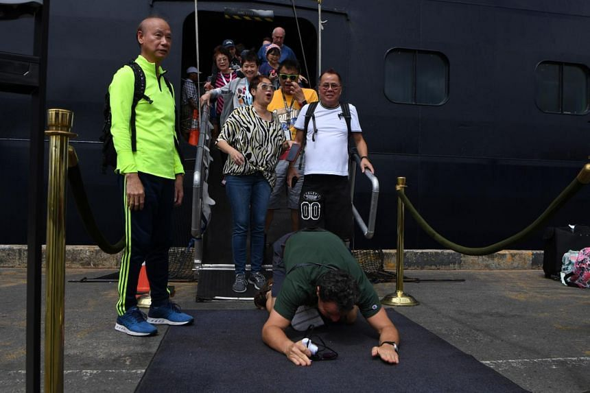 A passenger reacts as he disembarks from the Westerdam cruise ship in Sihanoukville, on Feb 14, 2020.