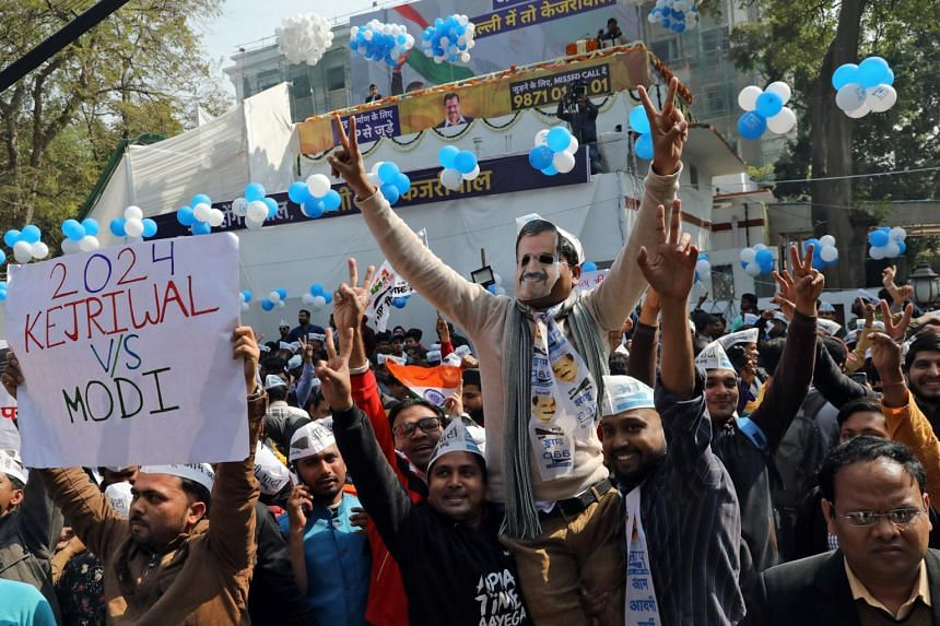 Supporters of Aam Aadmi Party celebrate at the party headquarters in New Delhi, India, on Feb 11, 2020.