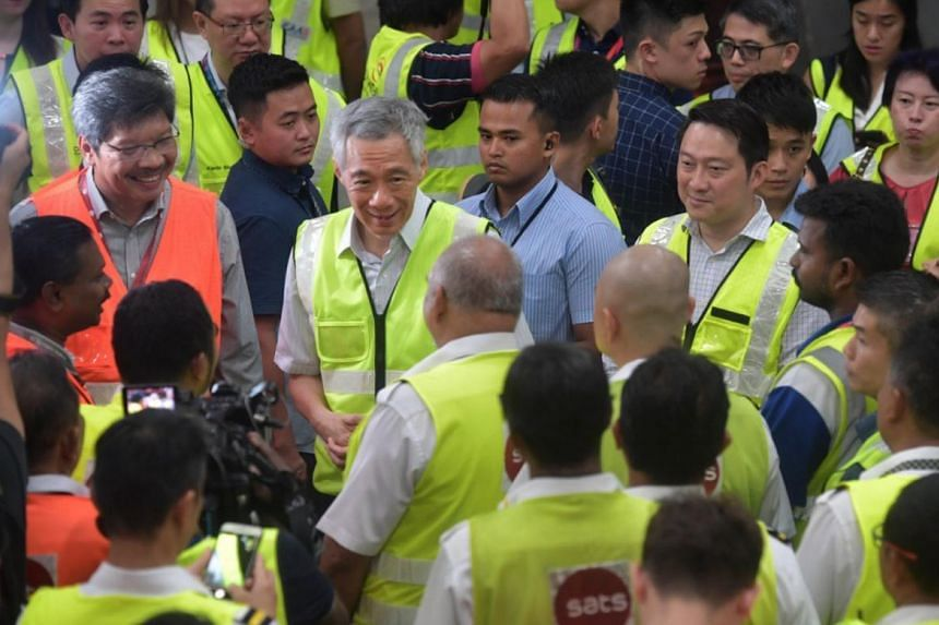 Prime Minister Lee Hsien Loong visiting workers from baggage handling at Changi Airport Terminal 3 on Feb 14, 2020.