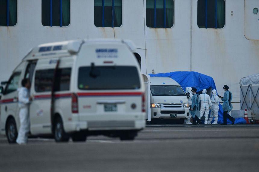 Officials at work near the quarantined Diamond Princess cruise ship at Daikoku Pier Cruise Terminal in Yokohama, on Feb 13, 2020.