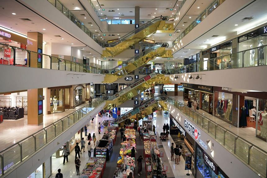 Shoppers in a mall in Singapore.