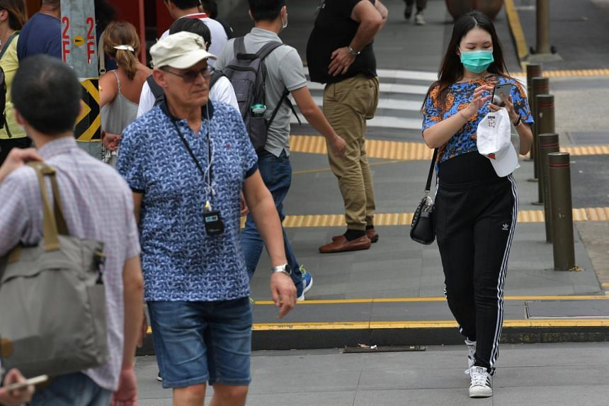 A woman wearing a surgical mask seen in Chinatown, Singapore, on Feb 4, 2020.