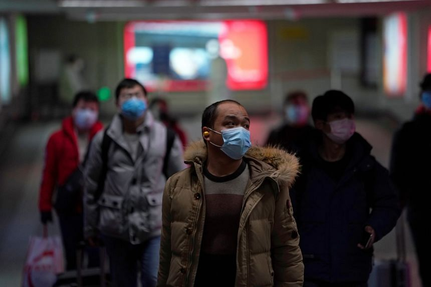 People wearing masks at a subway station in Shanghai, China, on Feb 13, 2020.