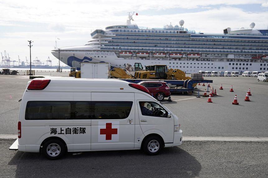 An ambulance waiting at the Daikoku Pier Cruise Terminal, where the Diamond Princess cruise ship is docked in Yokohama, south of Tokyo, Japan, on Feb 12, 2020.