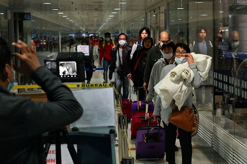 Travellers at the international airport in Manila on Feb 5, 2020. The Philippines will lift a travel ban it had imposed on visitors from Taiwan.
