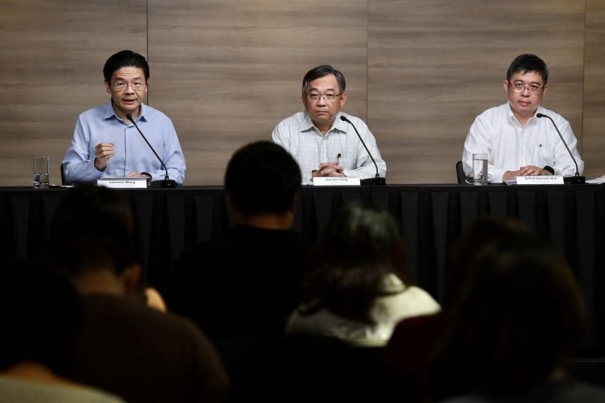 (From left) National Development Minister Lawrence Wong, Health Minister Gan Kim Yong and Director of Medical Services at the Ministry of Health Kenneth Mak during a press conference on Feb 14, 2020.