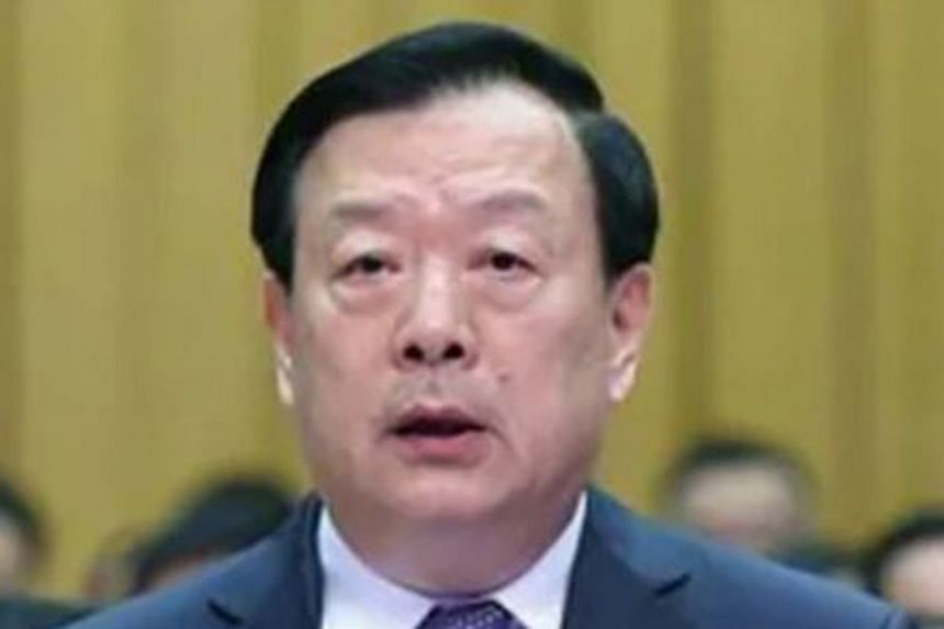 Mr Xia Baolong (above) was appointed as the new chief of the Hong Kong and Macau Affairs Office, taking over from predecessor Zhang Xiaoming (top), who has been demoted to deputy director. Observers say the move was triggered by the handling, or lack