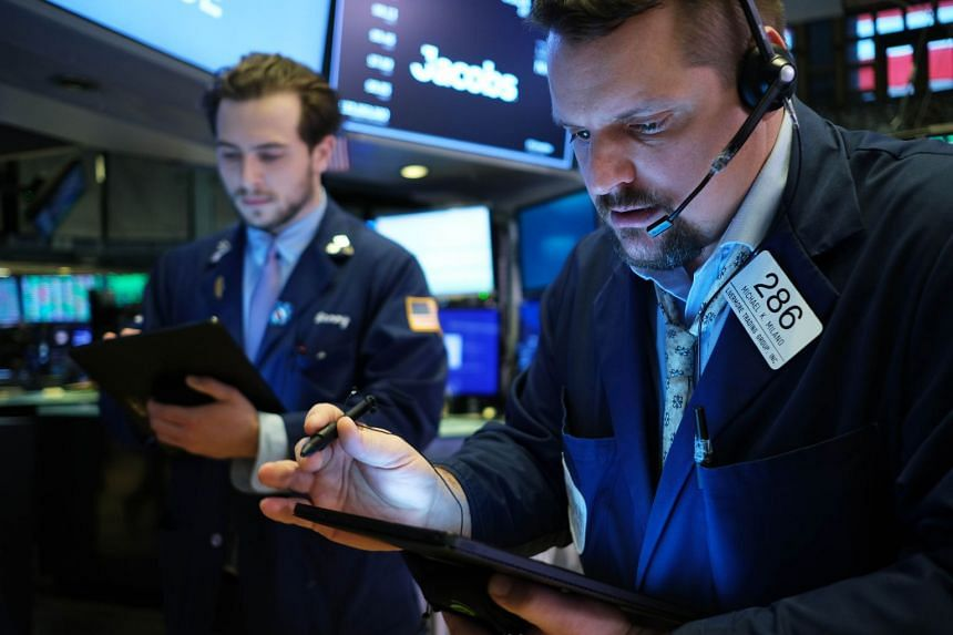 Traders work on the floor of the New York Stock Exchange, Feb 12, 2020.