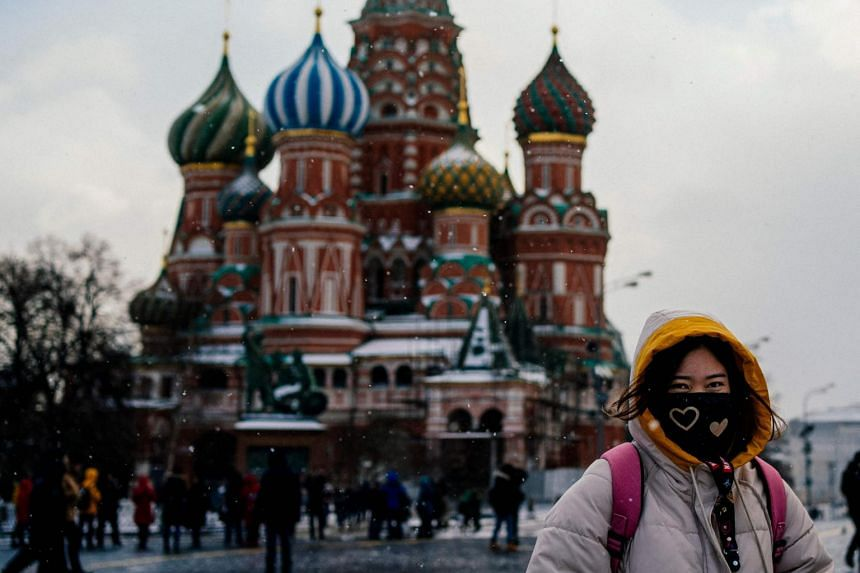 Tourists wearing face masks visit Red Square in downtown Moscow on Jan 23, 2020.