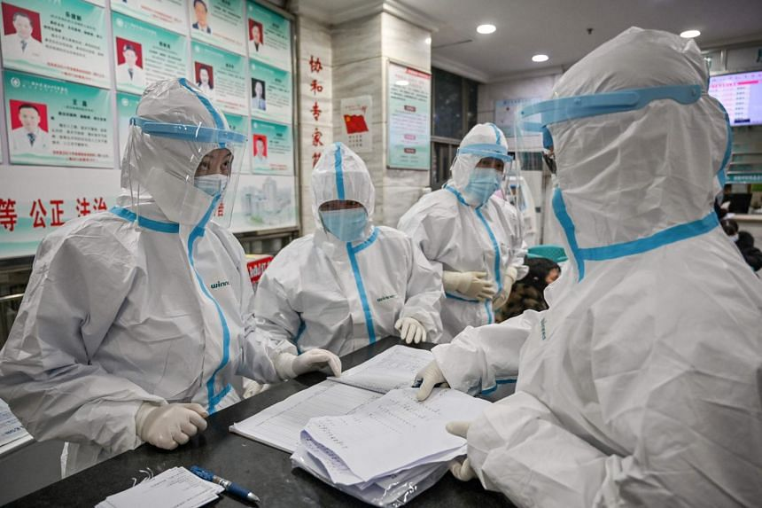 Medical staff in protective clothing working at the Wuhan Red Cross Hospital in Wuhan on Jan 25, 2020.