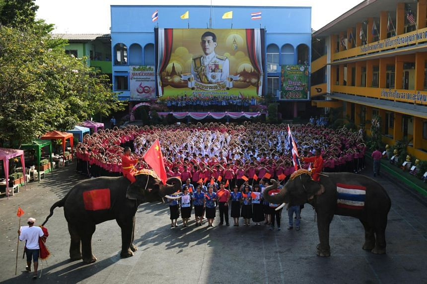 Elephants join Thai students as they form a heart shape on Valentine's Day to show their support for China in the fight against the coronavirus at a school in Ayutthaya, Thailand, on Feb 14, 2020.