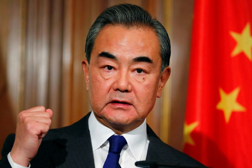 Chinese Foreign Minister Wang Yi holds a joint news conference with German Foreign Minister Heiko Maas in Berlin, Germany, Feb 13, 2020.